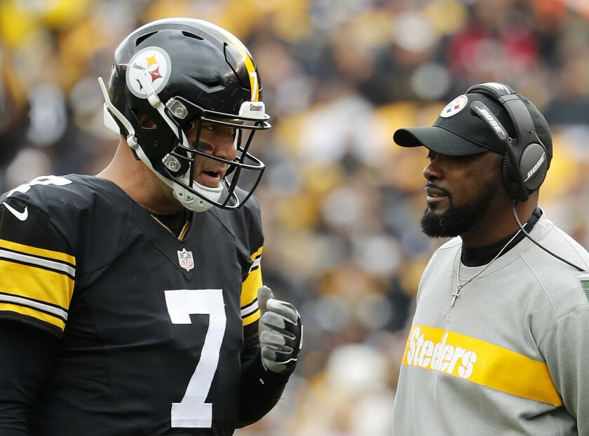 FILE - In this Oct. 28, 2018, file photo, Pittsburgh Steelers quarterback Ben Roethlisberger and coach Mike Tomlin during the team's NFL football game against the Cleveland Browns in Pittsburgh. Roethlisberger, who went out in Game 2 last season with an elbow injury, received lots of support as a candidate for comeback player of the year, at the halfway point of the season. Tomlin was lauded for coach of the year, at this point of the season, by Hall of Famer James Lofton and hall voter Rick Gosselin. (AP Photo/Winslow Townson, File)
