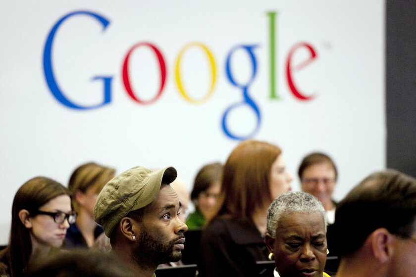 """FILE - In this Wednesday, Oct. 17, 2012, file photo, people attend a workshop, """"New York Get Your Business Online,"""" at Google offices in New York. Google Inc. reports quarterly earnings on Thursday, Jan. 30, 2014. (AP Photo/Mark Lennihan, File)"""