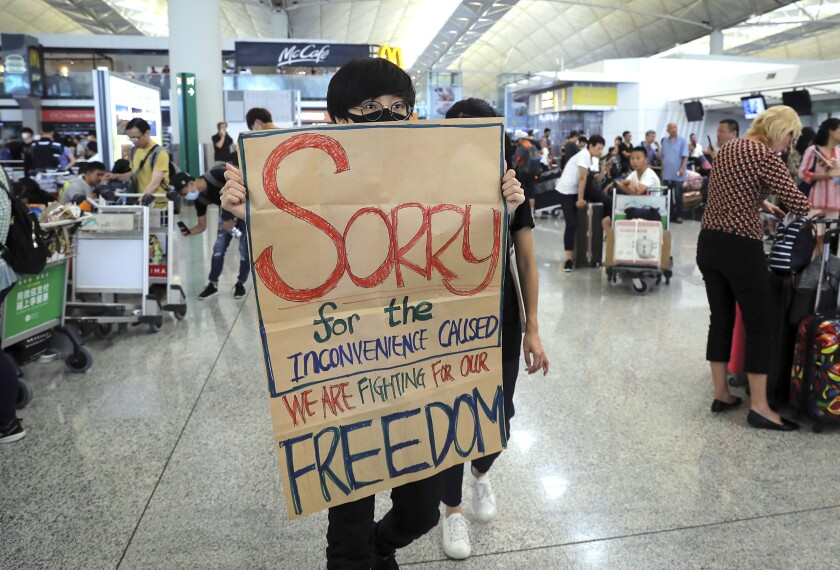 Protesters blocked passengers at departure halls of Hong Kong airport
