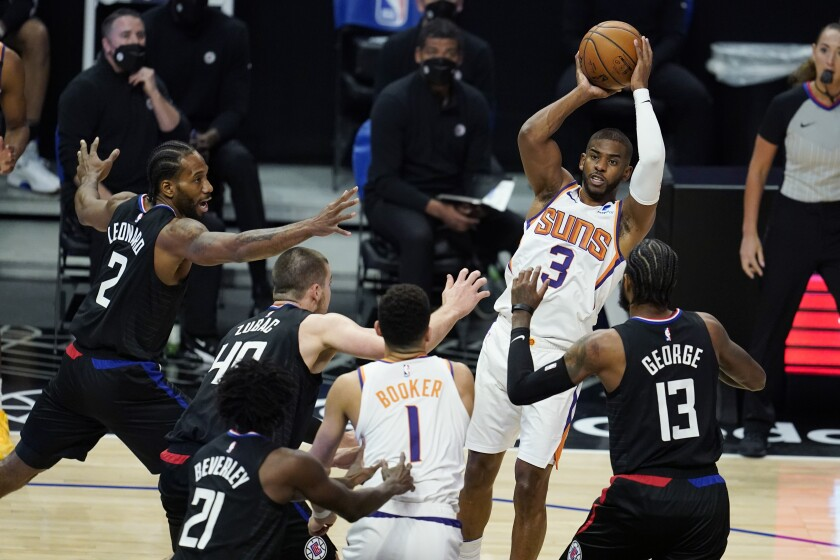 Chris Paul makes a pass over the Clippers' defense.