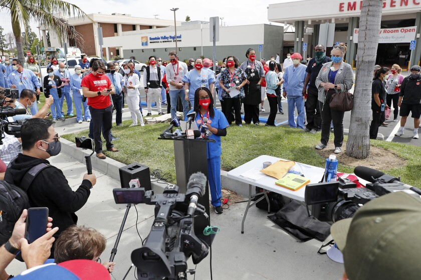 An employee speaks at a July 2 rally outside Fountain Valley Regional Hospital & Medical Center.
