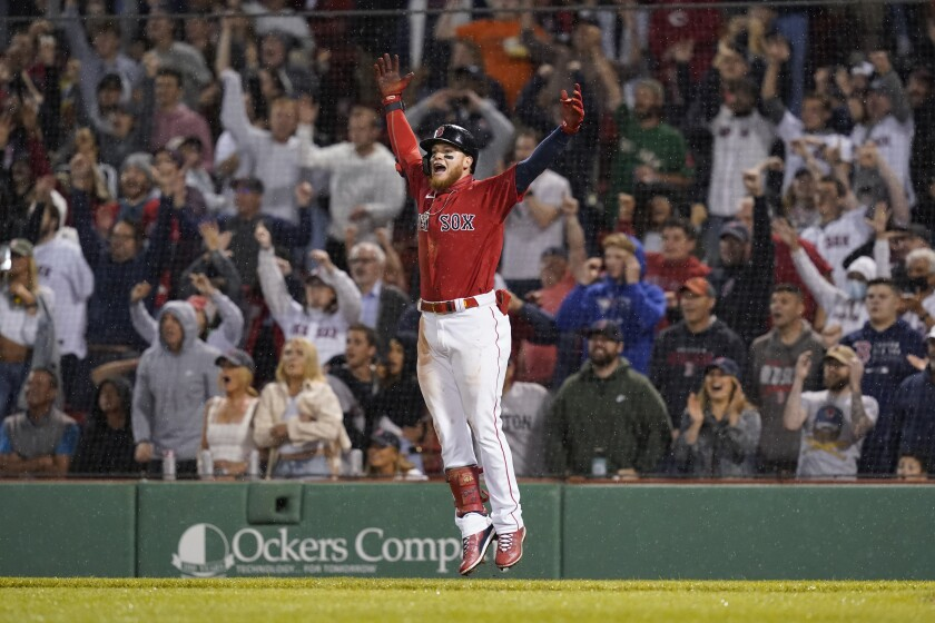 Boston Red Sox's Alex Verdugo celebrates after hitting a walkoff-single, driving in Danny Santana, in the ninth inning of a baseball game against the Toronto Blue Jays at Fenway Park, Friday, June 11, 2021, in Boston. (AP Photo/Elise Amendola)