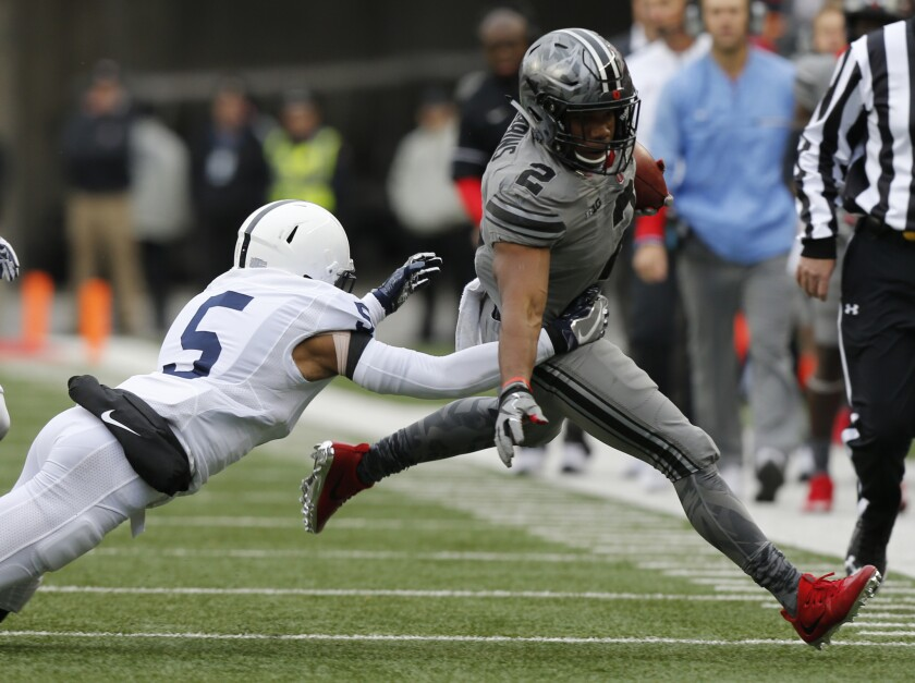 Ohio State running back J.K. Dobbins is pursued by Penn State defensive back Tariq Castro-Fields.