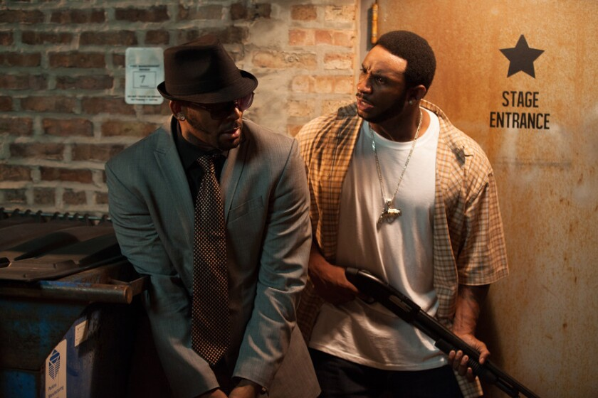 """R. Kelly, left, and Eric Lane in a scene from """"Trapped in the Closet."""" Kelly's hip-hopera is returning to IFC in 2014 with additional installments."""