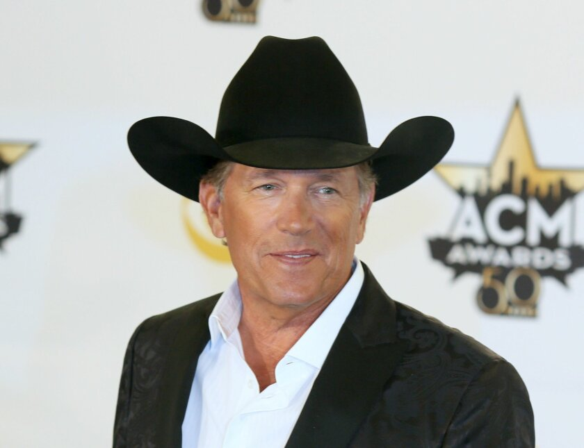 """FILE - In this April 19, 2015 file photo, George Strait poses in the press room with the milestone award at the 50th annual Academy of Country Music Awards in Arlington, Texas. Strait announced on Tuesday, Sept. 22, that he's releasing a new album, """"Cold Beer Conversation,"""" on Friday and that he'll play a series of shows at the new Las Vegas Arena when it opens in 2016. (Photo by Jack Plunkett/Invision/AP, File)"""