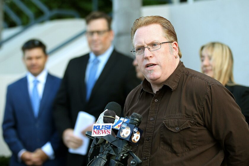 """San Diego attorney Cory Briggs unveils his """"Pay their own Way"""" initiative during a news conference where he was joined by backers of the measure."""