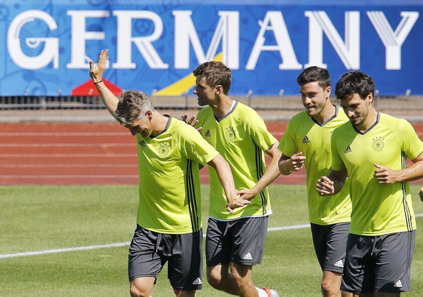 Bastian Schweinsteiger, Thomas Mueller, Jonas Hector and Mats Hummels, from left, run during the last training session of the German national football team at their base camp in Evian-Les-Bains, France, Wednesday, July 6, 2016. Germany will face France in a Euro 2016 semifinal soccer match in Marse