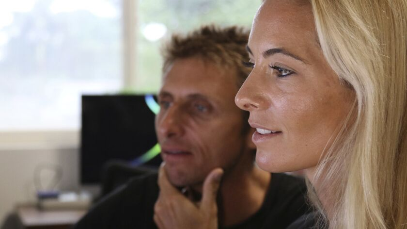 Juan Oliphant, left, and Ocean Ramsey, co-founders of One Ocean Diving and Research, look at footage