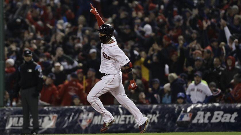 Boston's Eduardo Nunez reacts after hitting a three-run home run during the seventh inning of Game 1 of the World Series.