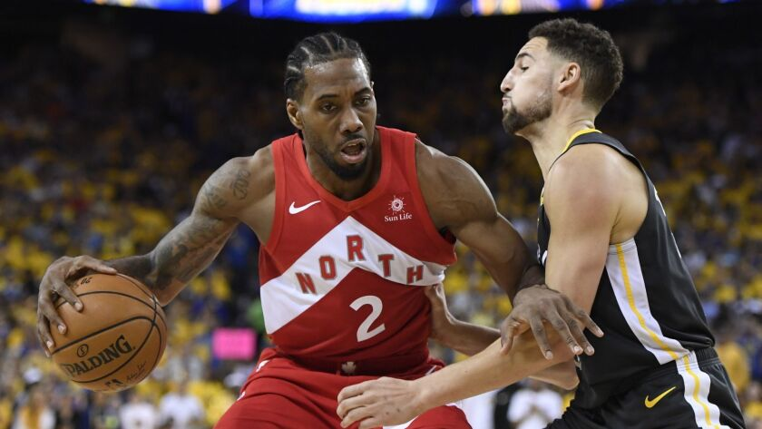 Toronto Raptors forward Kawhi Leonard, left, tries to drive past Golden State Warriors guard Klay Thompson during Game 6 of the NBA Finals. Will Leonard return to the Raptors?