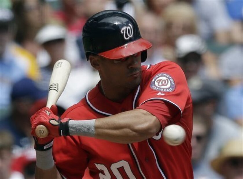 Washington Nationals' Ian Desmond is hit by a pitch during the second inning of a baseball game against the Milwaukee Brewers Sunday, Aug. 4, 2013, in Milwaukee. (AP Photo/Morry Gash)