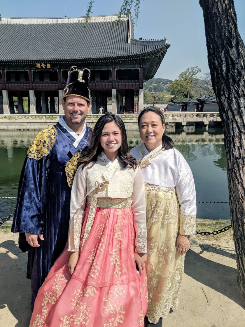 David, Jessica and Marian Phelps wearing hanboks, which are traditional Korean attire, in Seoul, South Korea in April 2019.