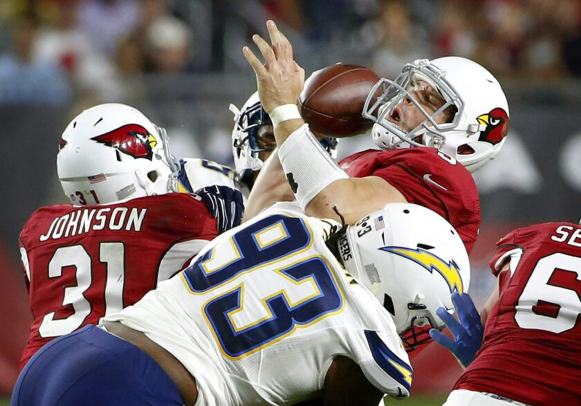 Arizona Cardinals' Drew Stanton, top, grimaces as he is sacked by San Diego Chargers' Darius Philon (93) during the first half of an NFL preseason football game Saturday, Aug. 22, 2015, in Glendale, Ariz. (AP Photo/Ross D. Franklin)