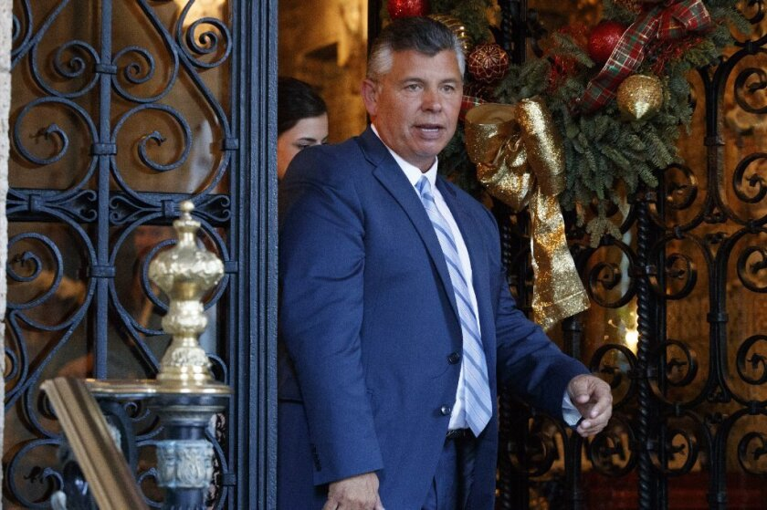 Central California farmer Abel Maldonado leaves President-elect Trump's mansion in Florida last month.