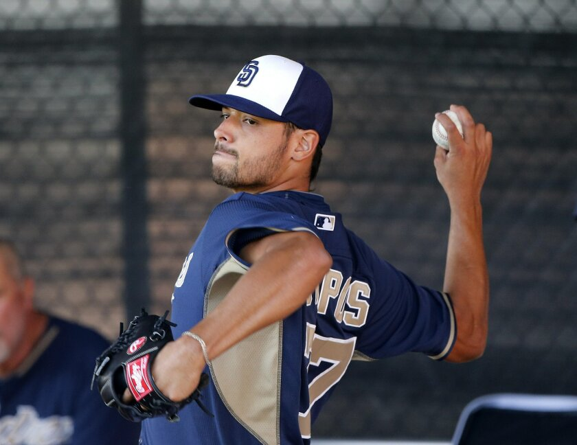 Padres pitcher Leonell Campos during a bullpen session as the third day of spring training began for the Padres pitchers and catchers.