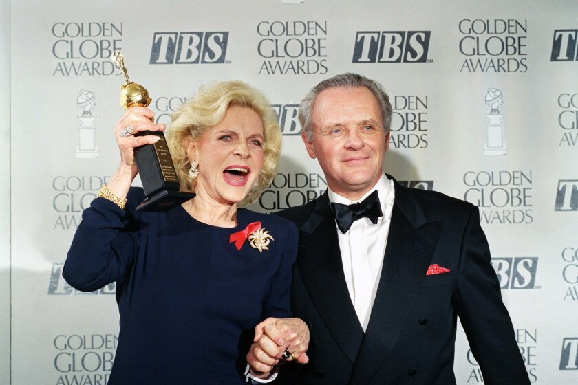 This Jan. 23, 1993 file photo shows actress Lauren Bacall holding up her Cecil B. DeMille Award for Lifetime Achievement with actor Anthony Hopkins backstage at the 50th Golden Globe Awards in Beverly Hills.  Bacall, the sultry-voiced actress, died Aug. 12, 2014. She was 89. (AP Photo/Reed Saxon, F