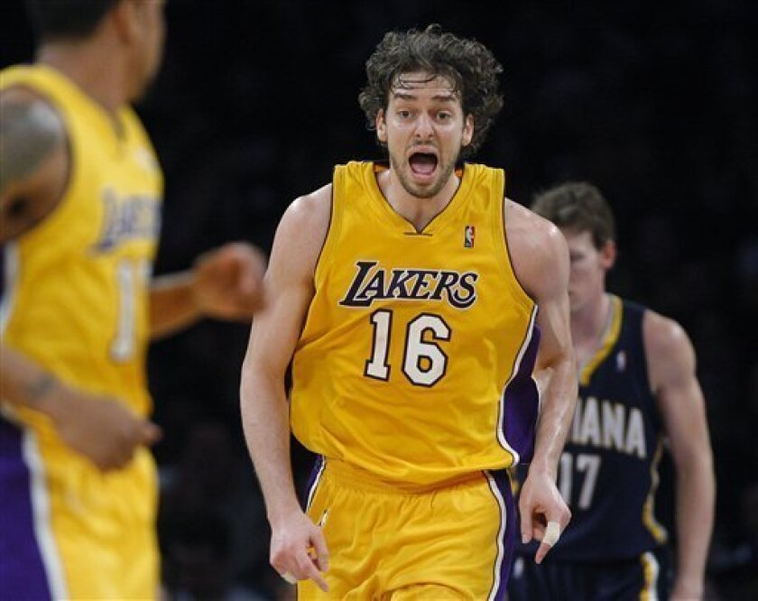 Los Angeles Lakers forward Pau Gasol, of Spain, reacts after making a basket during the first half of an NBA basketball game against the Indiana Pacers in Los Angeles, Tuesday, March 2, 2010. (AP Photo/Jae C. Hong)