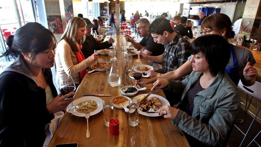 VENICE, CALIF. - FEBRUARY 11, 2013: Customers enjoy lunch at Hostaria del Piccolo in Venice on Febr