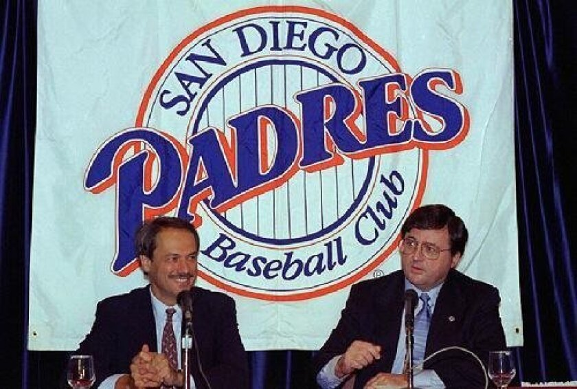 <strong>  1995:</strong> John Moores (right), with former executive Larry Lucchino, took over the  team after a strike-shortened 47-70 season. <em>U-T file photo</em>