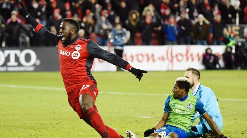 Toronto FC forward Jozy Altidore (17) celebrates after scoring against Seattle Sounders goalkeeper S
