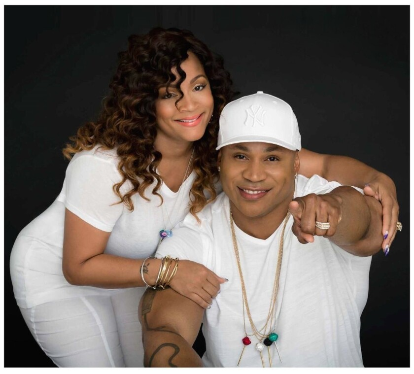 LL Cool J and jewelry designer Simone Smith strike a pose.