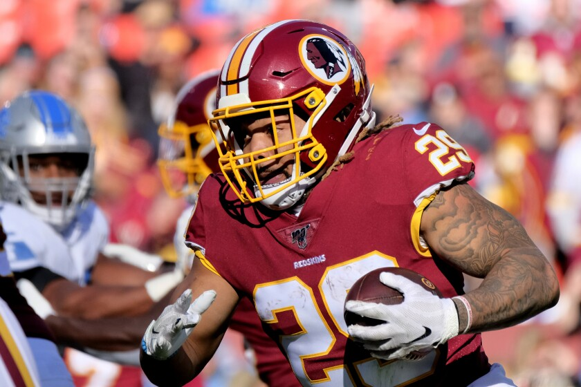 FILE - In this Nov. 24, 2019, file photo, Washington Redskins running back Derrius Guice (29) runs the ball during an NFL football game against the Detroit Lions in Landover, Md. The Washington Football Team has released Guice after he was charged in a domestic violence incident. (AP Photo/Mark Tenally, File)
