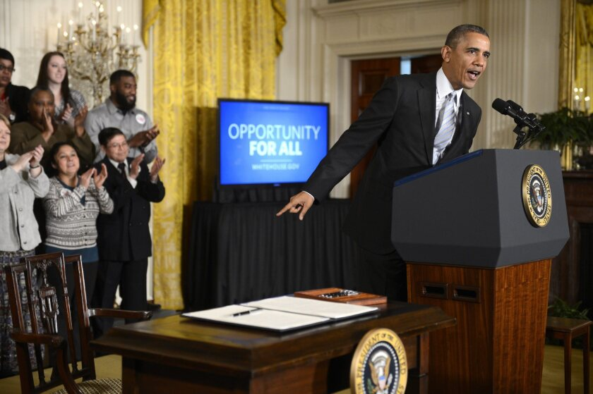 President Obama prepares to sign an executive order to raise the minimum wage for federal contractors to $10.10.