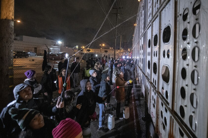 VERNON, CA, WEDNESDAY, FEBRUARY 20, 2019 - Dozens of people gather for a twice-weekly vigil for pig