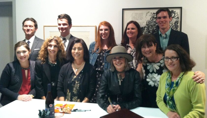 Diane Keaton (wearing a hat) poses with the staff of Warwick's Books April 9.
