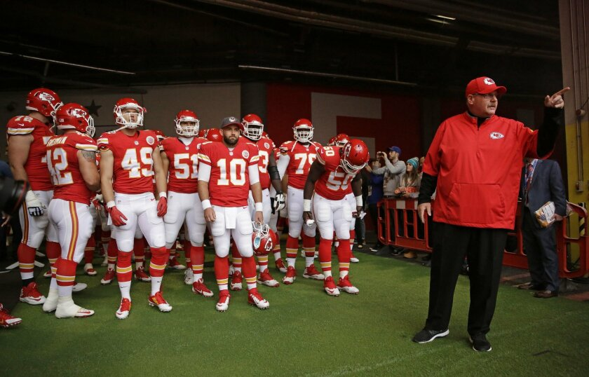 Kansas City Chiefs head coach Andy Reid, right, gestures before his team enters the field for the NFL football game between Detroit Lions and Kansas City Chiefs Wembley Stadium in London,  Sunday, Nov. 1, 2015. (AP Photo/Matt Dunham)