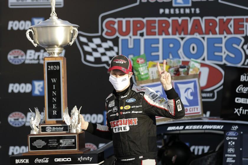 Brad Keselowski celebrates after winning a NASCAR Cup race at Bristol Motor Speedway.