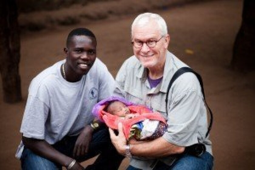"Lale Labuko and John Rowe with an ""Omo Child."" Courtesy photo"