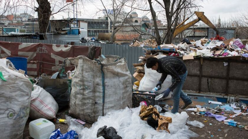 Afghans live in the Vefa neighborhood of Istanbul, Turkey. They make a living searching for plastic,