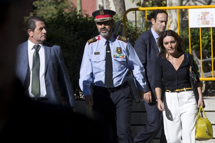 FILE - In this Oct. 6, 2017 file photo, Catalan regional police chief Josep Lluis Trapero, centre, leaves the national court in Madrid, Spain. A Madrid court on Wednesday Oct. 21, 2020 acquitted Trapero and the heads of Catalonia's regional police of charges of sedition and disobedience for what state prosecutors had argued was their alleged role in the northeast region's 2017 secession attempt. (AP Photo/Paul White, File)