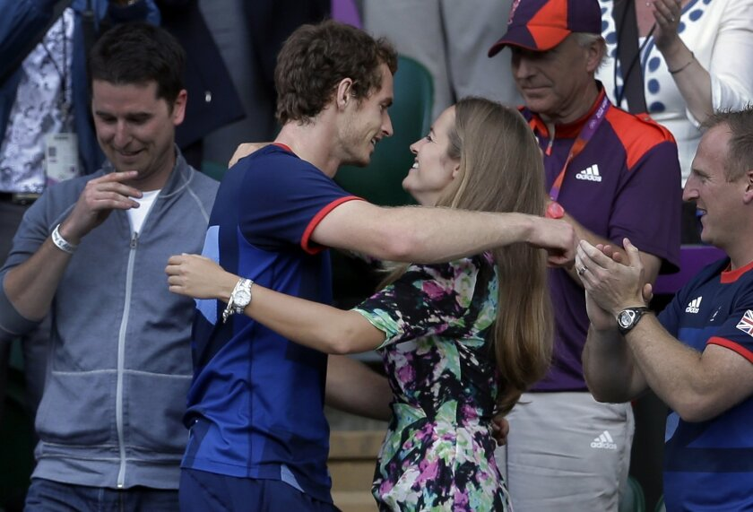 FILE - In this Sunday, Aug. 5, 2012 file photo, Britain's Andy Murray, center left, hugs his girlfriend Kim Sears, after defeating Switzerland's Roger Federer to win the men's singles 2012 Summer Olympics gold medal match, played at the All England Lawn Tennis Club, Wimbledon, in London. Andy Murra