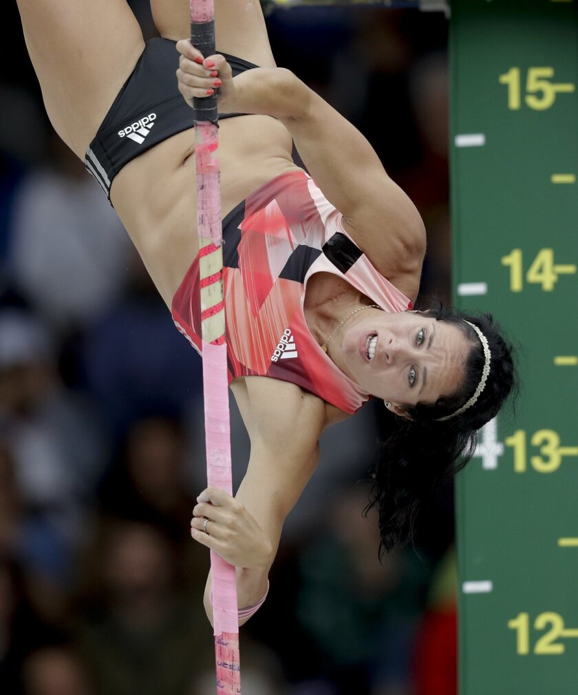 FILE - In this July 10, 2016, file photo, Jenn Suhr clears the bar during the women's pole vault final at the U.S. Olympic Track and Field Trials in Eugene Ore. If Russia's ban is upheld, the absence of world record-holder and two-time Olympic champion Yelena Isinbayeva will leave a hole in the women's pole vault competition _ particularly for Suhr. (AP Photo/Charlie Riedel, File)