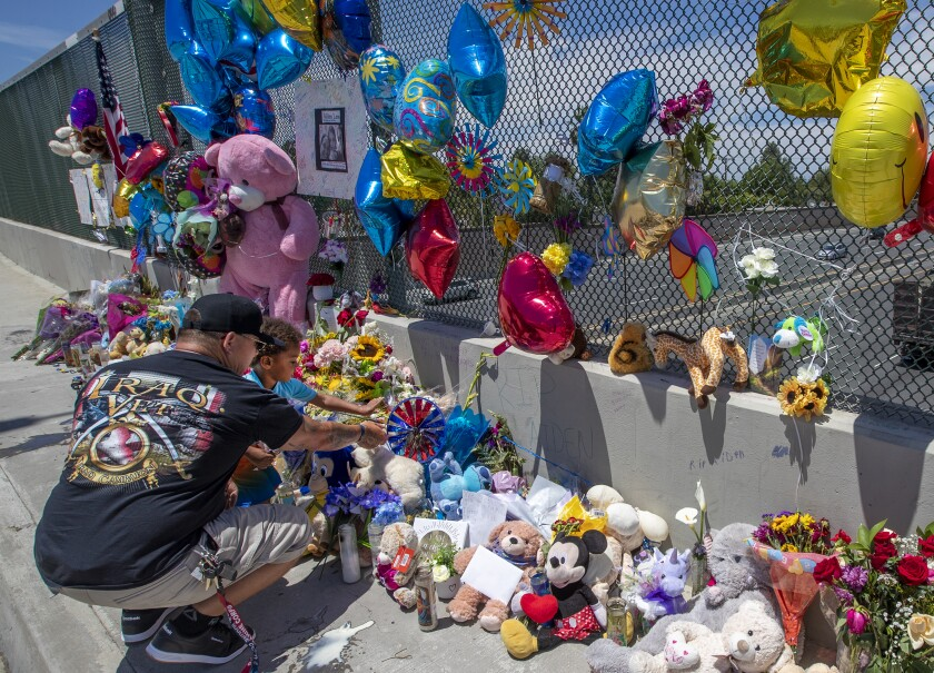 A memorial on the Walnut overpass over the 55 Freeway in Orange.