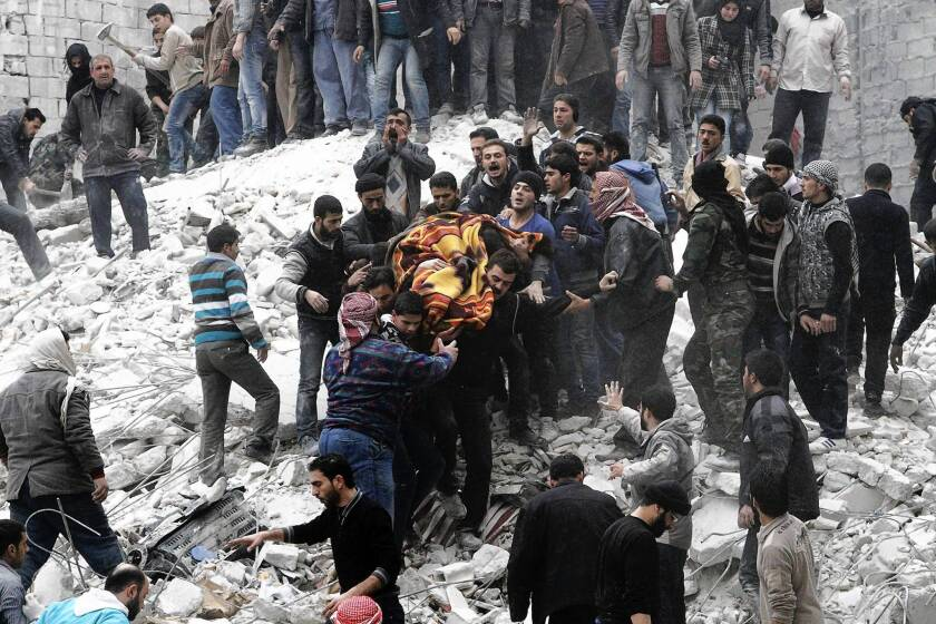 Syrians carry a body in Aleppo's Ansari neighborhood after a reported government airstrike. The opposition said the attack killed at least nine people.