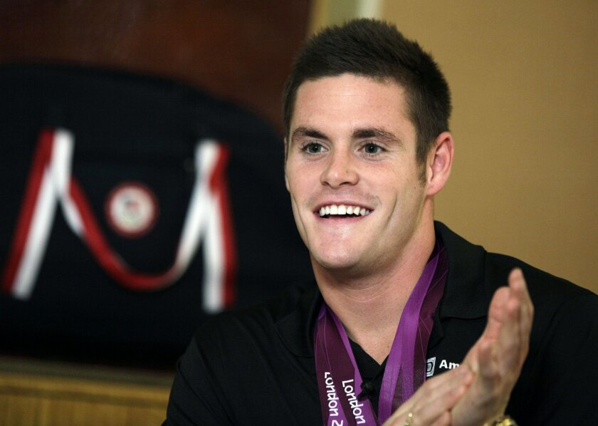 FILE - In this Aug. 13, 2012, file photo, David Boudia, who came back from the London Summer Olympics having won both gold and bronze in diving, speaks during an interview in New York. Boudia is likely to be the most experienced diver on this year's U.S. men's team, and he's still the Americans' be