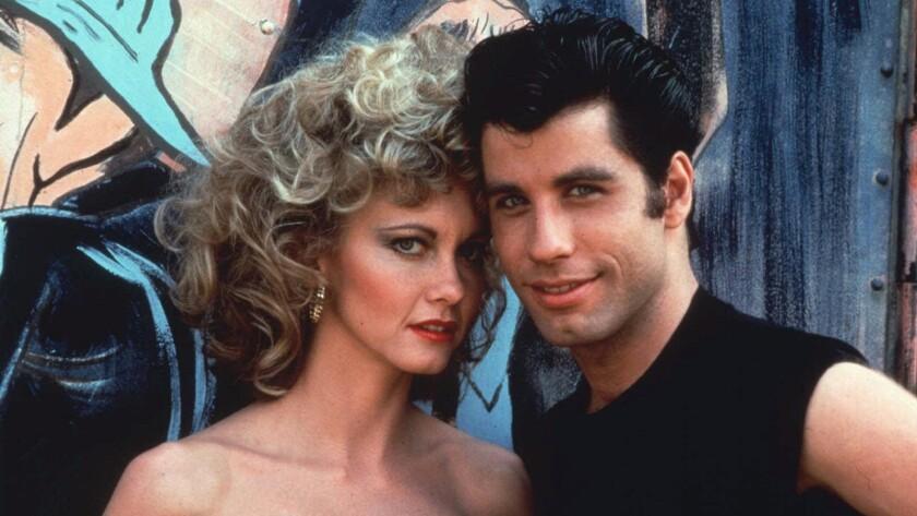 "Olivia Newton-John and John Travolta in the 1978 film ""Grease,"""