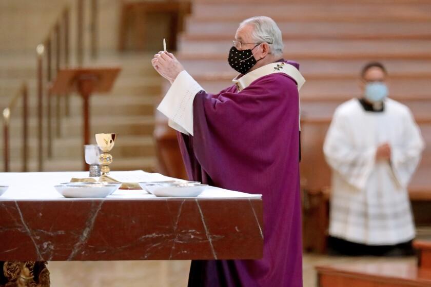Archbishop of Los Angeles José H. Gómez leads a service.