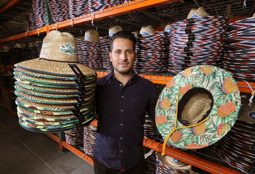 Anthony Lora, founder of the Hemlock Hat Co., at his company's Vista warehouse and headquarters.