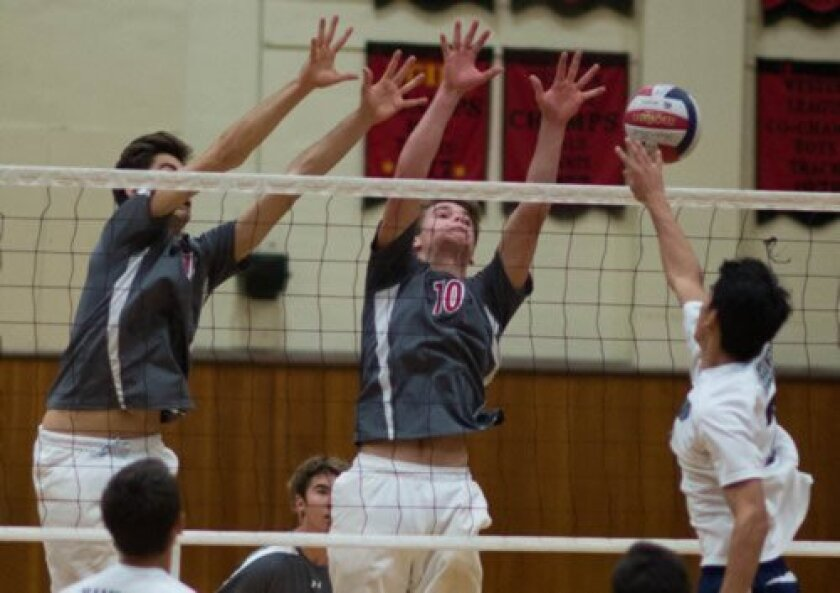 Palatella and Chapman apply the block against Kamehameha, Hawaii, in the Beach City invitational March 20.