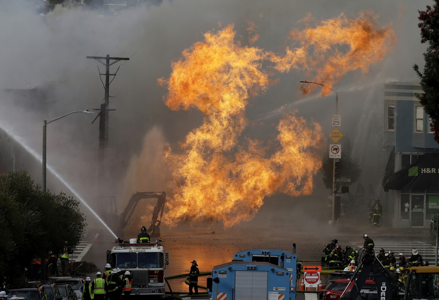A gas explosion in San Francisco shot flames high into the air Wednesday and was burning four buildings as utility crews scrambled to shut off the flow of gas. Construction workers may have cut a natural gas line, Fire Chief Joanne Hayes-White said.