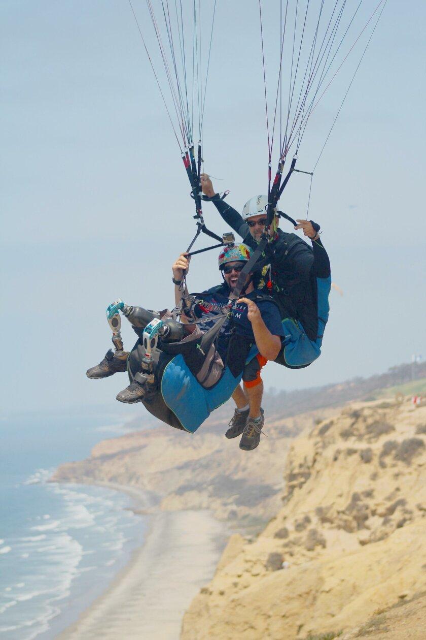 Joshua Elliot and J.C. Perren hovering along the skies of Black's Beach.
