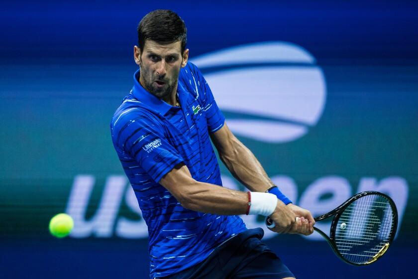 Novak Djokovic hits a return during his straight-sets victory over Denis Kudla on Aug. 30.