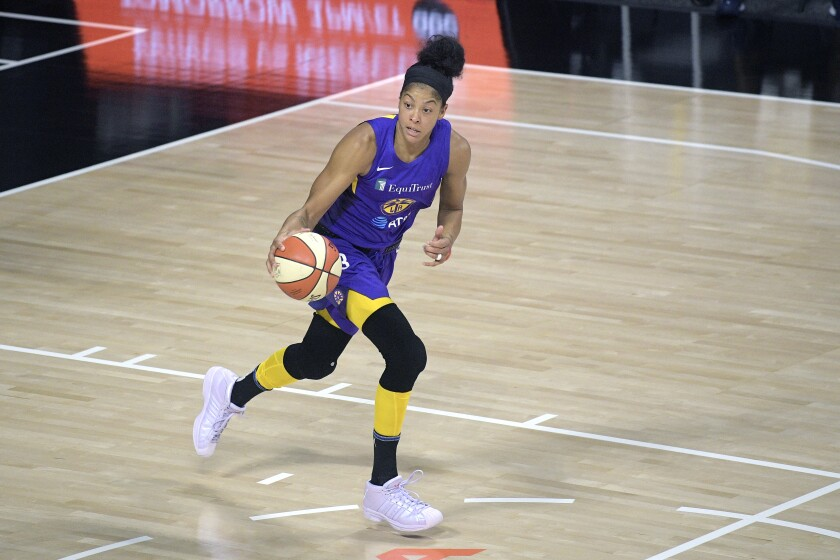 Candace Parker brings the ball up the court for the Sparks during a game on Aug. 15.