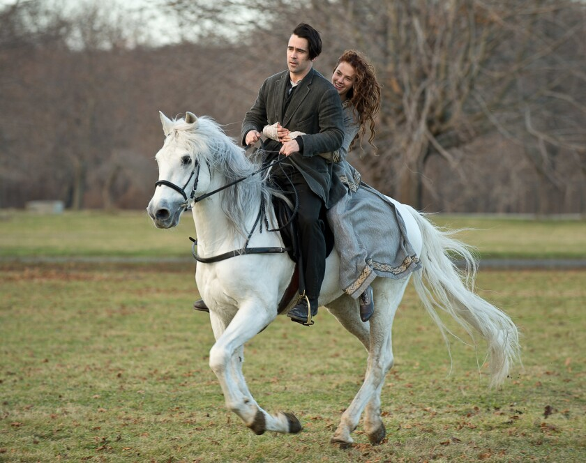 """Colin Farrell is Peter Lake and Jessica Brown Findlay is Beverly Penn in """"Winter's Tale."""""""