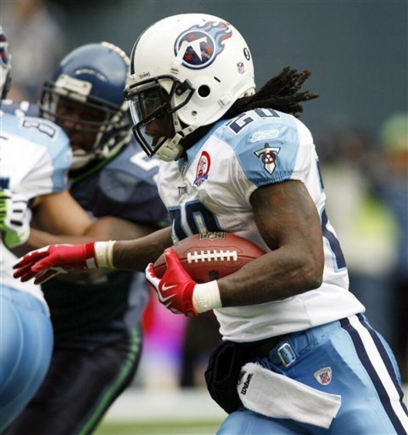 Tennessee Titans' Chris Johnson runs the ball against the Seattle Seahawks the first quarter Sunday, Jan. 3, 2010, during an NFL football game in Seattle. (AP Photo/John Froschauer)
