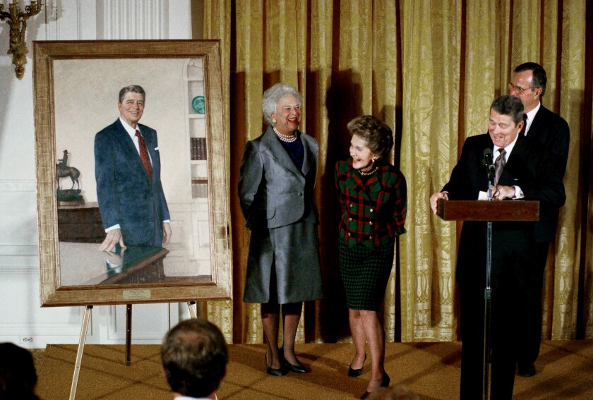 Former President Ronald Reagan and his wife Nancy with then-President George H. W. Bush